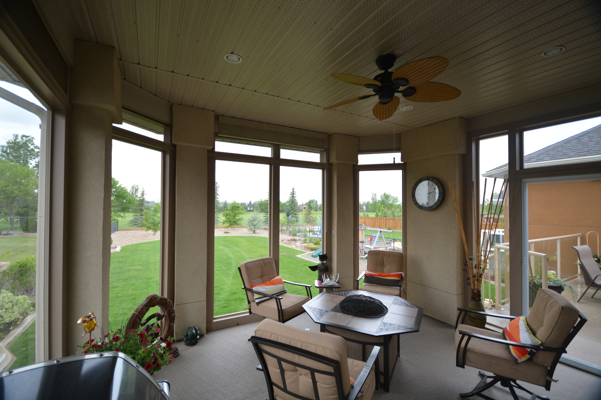 Alta Aluminum Sunroom with furniture around a small fire pit
